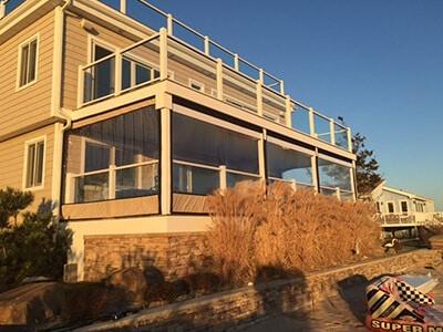 clear vinyl panels keep beach house porch warm